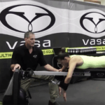 Coach working with athlete to improve technique on Vasa Trainer