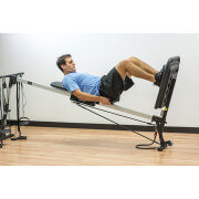 Athlete performing squat on exercise machine
