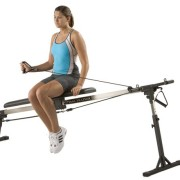Woman performing shoulder external rotation on swim bench