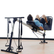 Athlete performing leg exercises on Vasa Trainer