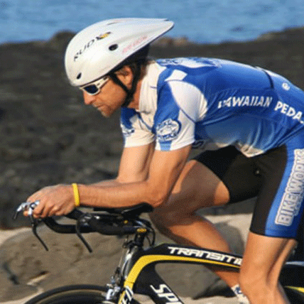 Triathlete in aero position on bike