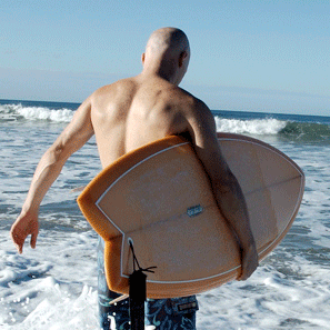Tomas Anthony Surfer walking into ocean
