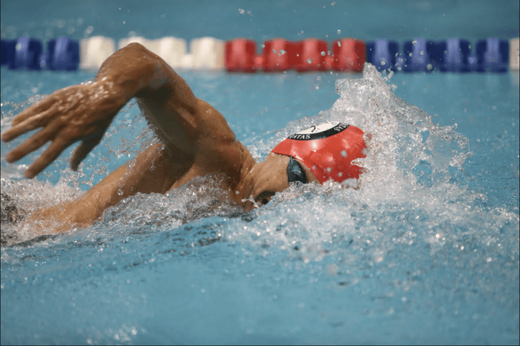 Masters swimmer competing in pool