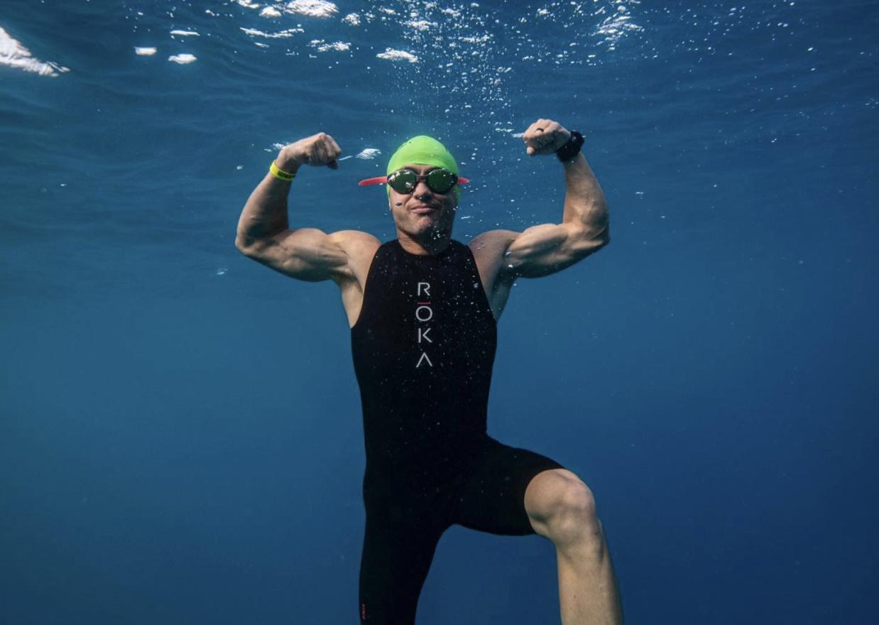 Ironman swimmer flexes muscles